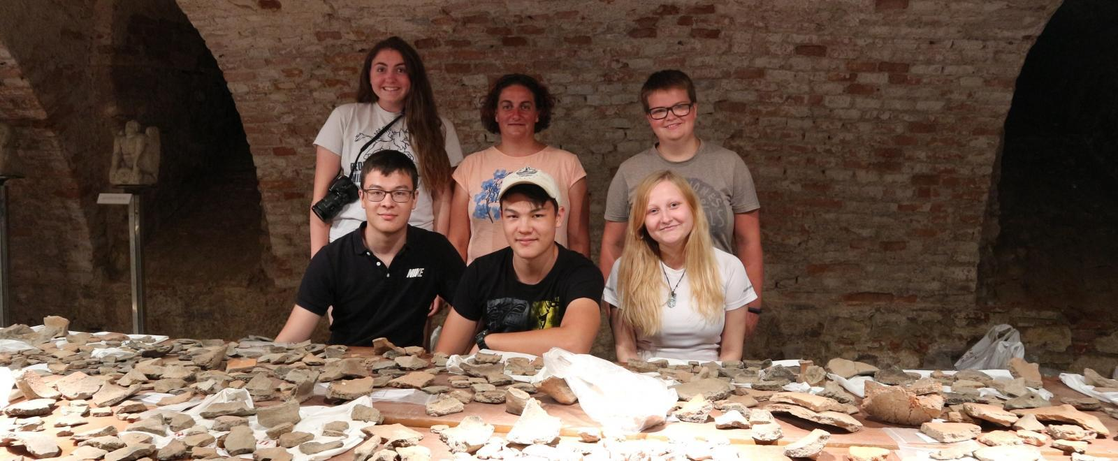 Volunteers on the Archaeology in Romania for Teenagers project analyse their findings.